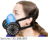 Woman with respirator mask, dust mask and safety mask for chemical industry. Side view, isolated on white background. Стоковое фото, фотограф Кекяляйнен Андрей / Фотобанк Лори