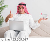Купить «Young arab businessman in business concept», фото № 33309097, снято 14 октября 2016 г. (c) Elnur / Фотобанк Лори