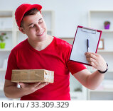 Купить «Post man delivering a parcel package», фото № 33309329, снято 6 июня 2017 г. (c) Elnur / Фотобанк Лори