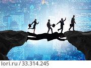 Купить «Businessman acting as a bridge in support concept», фото № 33314245, снято 3 апреля 2020 г. (c) Elnur / Фотобанк Лори
