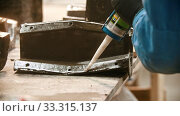 Купить «Concrete industry - young man worker applying glue on the part of whole detail», видеоролик № 33315137, снято 5 июня 2020 г. (c) Константин Шишкин / Фотобанк Лори