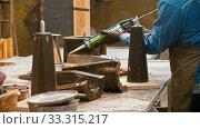 Купить «Concrete industry - young man worker applying glue on the detail», видеоролик № 33315217, снято 8 апреля 2020 г. (c) Константин Шишкин / Фотобанк Лори