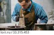 Купить «Concrete industry - man working with glued concrete detail», видеоролик № 33315453, снято 8 апреля 2020 г. (c) Константин Шишкин / Фотобанк Лори