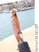 Купить «Beautiful fancy girl pulling suitcase on marina», фото № 33321337, снято 9 апреля 2020 г. (c) PantherMedia / Фотобанк Лори