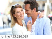 Купить «Fancy romantic couple in town embracing each other», фото № 33326089, снято 9 апреля 2020 г. (c) PantherMedia / Фотобанк Лори