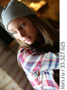 Young trendy girl with lonesome expression. Стоковое фото, фотограф Fabrice Michaudeau / PantherMedia / Фотобанк Лори