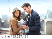 Couple on Top of the Rock observation desk with city guide. Стоковое фото, фотограф Fabrice Michaudeau / PantherMedia / Фотобанк Лори