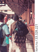 People locals and tourists go on 1 track of the railway station platform in Galle Sri Lanka (2019 год). Стоковое фото, фотограф katalinks / Фотобанк Лори