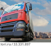 Купить «Big powerful truck in front of blue bright sky», фото № 33331897, снято 11 июля 2013 г. (c) Юрий Бизгаймер / Фотобанк Лори