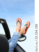 Closeup of feet with flip flops showing by car window. Стоковое фото, фотограф Fabrice Michaudeau / PantherMedia / Фотобанк Лори