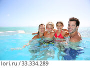 Купить «Happy family enjoying bath time in infinity pool», фото № 33334289, снято 8 апреля 2020 г. (c) PantherMedia / Фотобанк Лори