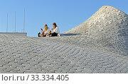 Купить «Amos Rex Art Museum in grounds of Lasipalatsi, underground gallery wit domes which bubble up above ground level. Tourists on roof», фото № 33334405, снято 30 июня 2019 г. (c) Валерия Попова / Фотобанк Лори