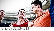 Купить «Composite image of sportsmen with arms around each other», фото № 33334513, снято 16 июля 2020 г. (c) Wavebreak Media / Фотобанк Лори