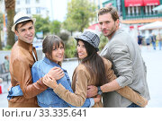 Купить «Group of young people hanging out together in town», фото № 33335641, снято 6 апреля 2020 г. (c) PantherMedia / Фотобанк Лори