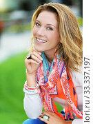 Купить «Portrait of beautiful smiling woman with colourful scarf», фото № 33337197, снято 2 июля 2020 г. (c) PantherMedia / Фотобанк Лори