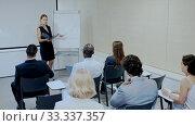 Купить «Young successful businesswoman sharing business ideas with colleagues in meeting room. Concept of teamwork», видеоролик № 33337357, снято 1 апреля 2020 г. (c) Яков Филимонов / Фотобанк Лори