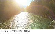 Купить «Low altitude flight over fresh fast mountain river with rocks at sunny summer morning.», видеоролик № 33340889, снято 8 апреля 2019 г. (c) Александр Маркин / Фотобанк Лори
