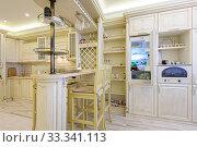 Luxury modern beige kitchen interior. Стоковое фото, фотограф Сергей Старуш / Фотобанк Лори