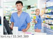 Купить «Female and male specialist are attentively stocktaking medicines», фото № 33341389, снято 26 марта 2018 г. (c) Яков Филимонов / Фотобанк Лори