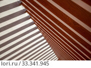Background of wooden planks arranged diagonally, Diagonal boards with light incidence. Format-filling view of diagonally arranged wooden planks with uniform gaps and rear light incidence. Стоковое фото, фотограф Evgenii Mitroshin / Фотобанк Лори