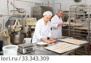 Купить «Female baker kneading a dough», фото № 33343309, снято 28 мая 2020 г. (c) Яков Филимонов / Фотобанк Лори
