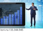 Купить «Businessman standing next to tablet computer in business concept», фото № 33344945, снято 2 июля 2020 г. (c) Elnur / Фотобанк Лори