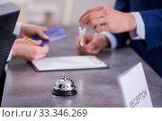Купить «Hotel reception bell at the counter», фото № 33346269, снято 13 июня 2019 г. (c) Elnur / Фотобанк Лори