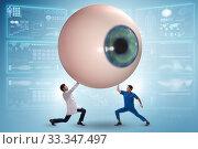 Купить «Doctor examining giant eye in medical concept», фото № 33347497, снято 9 апреля 2020 г. (c) Elnur / Фотобанк Лори