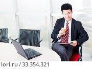 Купить «Handsome chinese young businessman with digital tablet in modern office», фото № 33354321, снято 13 июля 2020 г. (c) easy Fotostock / Фотобанк Лори