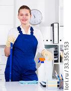 Купить «Female office cleaner is satisfied after cleaning», фото № 33355153, снято 9 июня 2017 г. (c) Яков Филимонов / Фотобанк Лори
