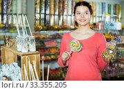Купить «girl buying candies at shop», фото № 33355205, снято 22 марта 2017 г. (c) Яков Филимонов / Фотобанк Лори