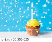 Купить «birthday cupcake with one burning candle», фото № 33355625, снято 30 июня 2016 г. (c) Syda Productions / Фотобанк Лори