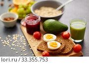 toast bread, eggs, avocado, jam, tomato and juice. Стоковое фото, фотограф Syda Productions / Фотобанк Лори