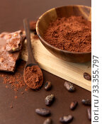 Купить «chocolate with hazelnuts, cocoa beans and powder», фото № 33355797, снято 1 февраля 2019 г. (c) Syda Productions / Фотобанк Лори