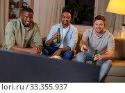 Купить «happy male friends with beer watching tv at home», фото № 33355937, снято 28 декабря 2019 г. (c) Syda Productions / Фотобанк Лори