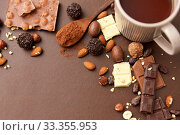 hot chocolate with nuts, cocoa powder and candies. Стоковое фото, фотограф Syda Productions / Фотобанк Лори