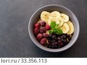 Купить «cereal breakfast with berries, banana and mint», фото № 33356113, снято 1 ноября 2018 г. (c) Syda Productions / Фотобанк Лори