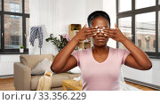Купить «african woman with closed eyes over dirty room», фото № 33356229, снято 26 января 2020 г. (c) Syda Productions / Фотобанк Лори