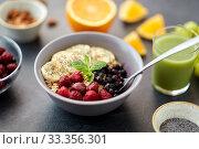 Купить «cereal breakfast with berries, banana and spoon», фото № 33356301, снято 1 ноября 2018 г. (c) Syda Productions / Фотобанк Лори