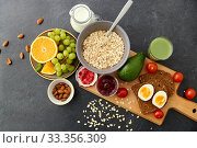 oatmeal, fruits, toast bread, egg, jam and milk. Стоковое фото, фотограф Syda Productions / Фотобанк Лори