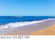 Купить «Foamy surf on a sandy beach», фото № 33357141, снято 24 сентября 2019 г. (c) Евгений Ткачёв / Фотобанк Лори