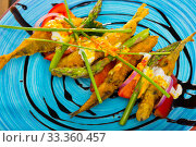 Купить «Fried in batter and creamy-ginger sauce sardines, served with sweet tomatoes», фото № 33360457, снято 23 августа 2018 г. (c) Яков Филимонов / Фотобанк Лори