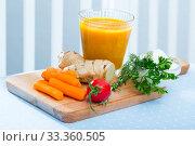 Купить «Freshly squeezed carrot-ginger juice», фото № 33360505, снято 26 мая 2020 г. (c) Яков Филимонов / Фотобанк Лори