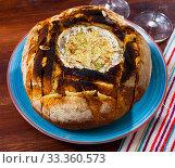 Купить «Camembert cheese fondue in bread», фото № 33360573, снято 16 июля 2020 г. (c) Яков Филимонов / Фотобанк Лори