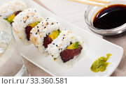 Купить «Delicious uramaki sushi with raw tuna at plate with soy sauce», фото № 33360581, снято 13 июля 2020 г. (c) Яков Филимонов / Фотобанк Лори