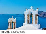 Bell towers of greek church above the sea in Santorini (2018 год). Стоковое фото, фотограф Роман Сигаев / Фотобанк Лори