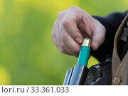 Купить «Man loading cartridge into shot gun when out hunting small game, Bas-Rhin, France, November.», фото № 33361033, снято 11 марта 2020 г. (c) Nature Picture Library / Фотобанк Лори