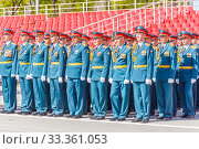 Купить «Russia, Samara, May 2016: The construction of soldiers with rifles for Victory Day at the rehearsal of the parade on Kuibyshev Square on a spring sunny day.», фото № 33361053, снято 7 мая 2017 г. (c) Акиньшин Владимир / Фотобанк Лори