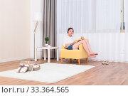 Купить «Young pretty chinese woman relaxing in room», фото № 33364565, снято 10 июля 2020 г. (c) age Fotostock / Фотобанк Лори