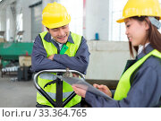 Купить «Young chinese man and woman work in motor manufacturing factory», фото № 33364765, снято 10 июля 2020 г. (c) easy Fotostock / Фотобанк Лори